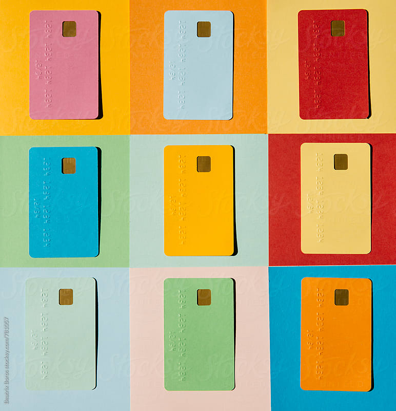 Colorful credit cards on colorful checked background by Beatrix Boros for Stocksy United