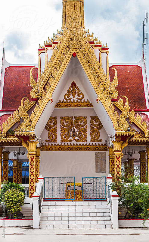 Entrance to buddhist temple with golden ornaments. by Audrey Shtecinjo for Stocksy United