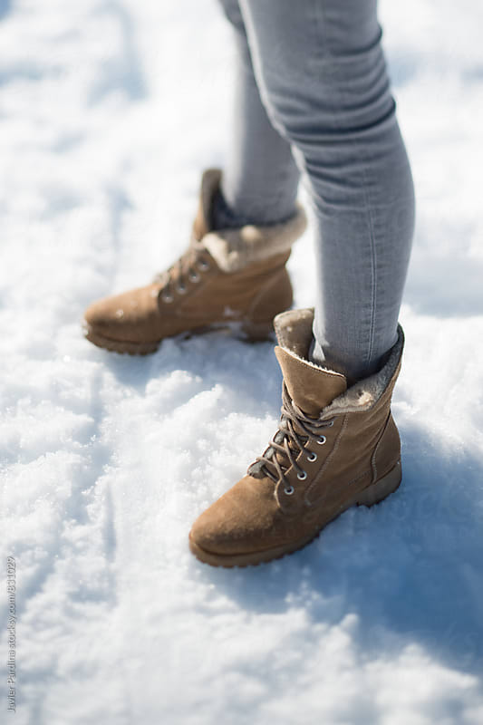 part of leads with winter boots on the snow by Javier Pardina for Stocksy United