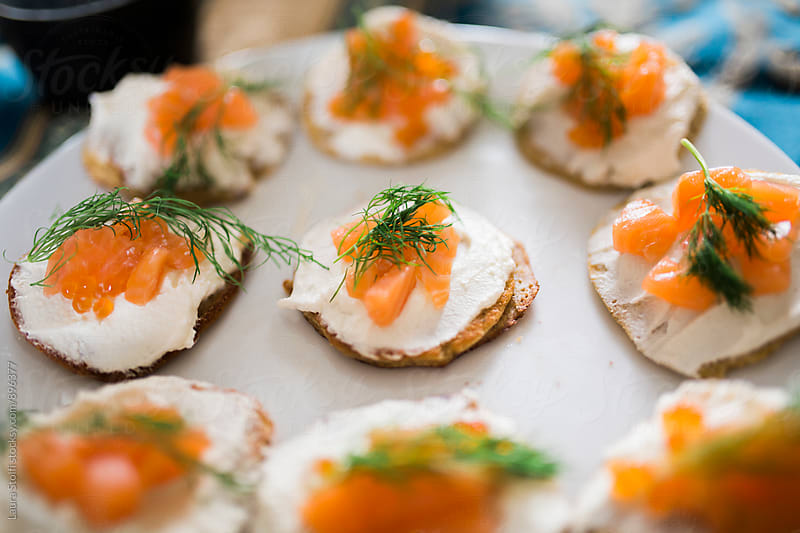 Homemade blinis with sour cream, salmon, caviar and fresh dill by Laura Stolfi for Stocksy United