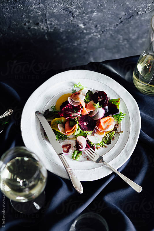 Smoked salmon salad by Ellie Baygulov for Stocksy United