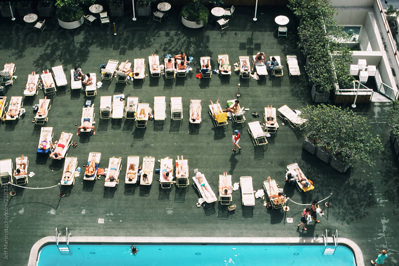 Lounge chairs near a pool by Jeff Marsh for Stocksy United