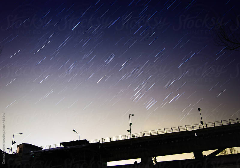 Star trailsn at night by Cosma Andrei for Stocksy United