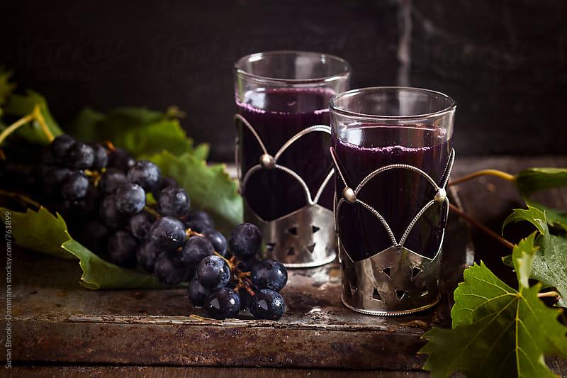Grape juice by Susan Brooks-Dammann for Stocksy United