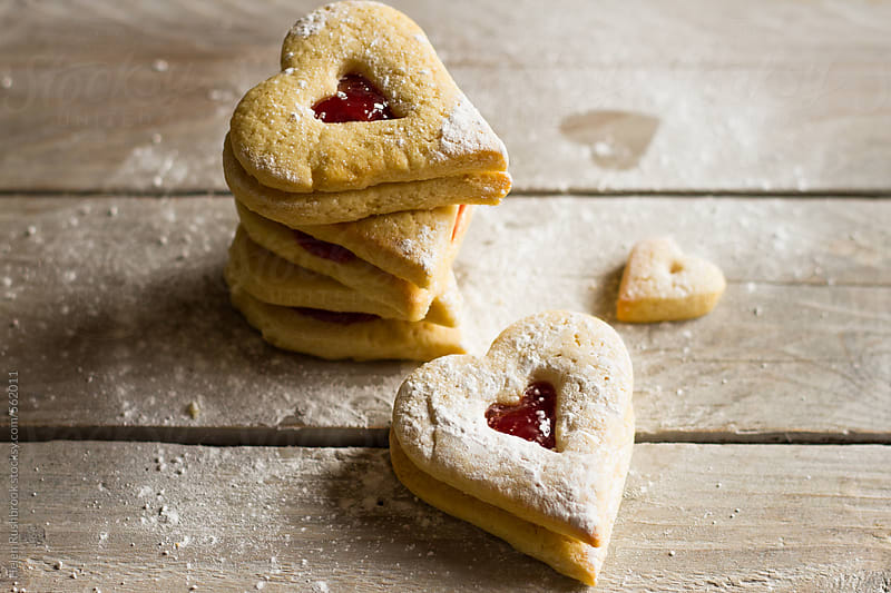 Heart-shaped jam sandwich cookies by Helen Rushbrook for Stocksy United