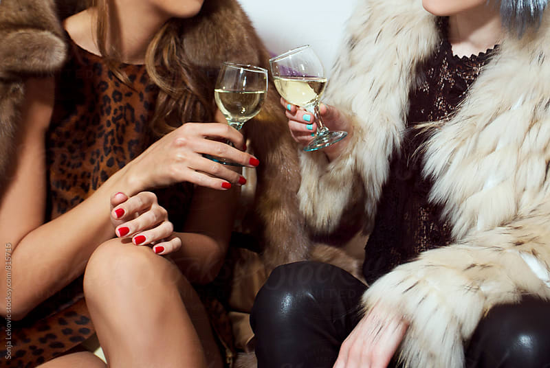 friends in fur coats drinking by Sonja Lekovic for Stocksy United