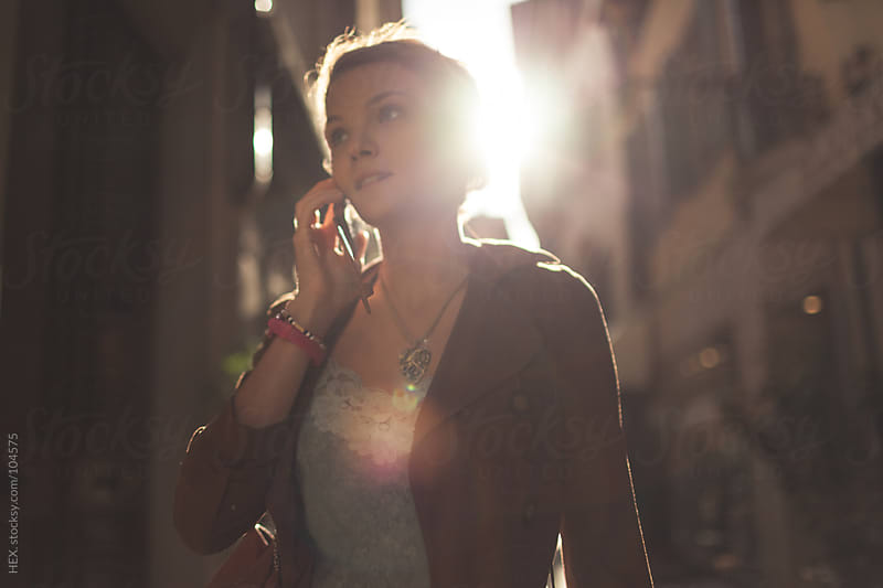 Young Woman On the Phone by HEX. for Stocksy United