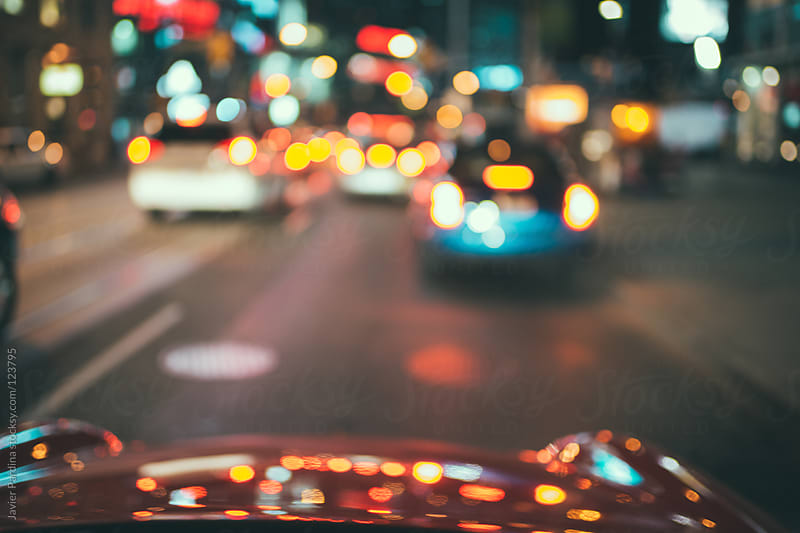 take a drive around the city at night by Javier Pardina for Stocksy United
