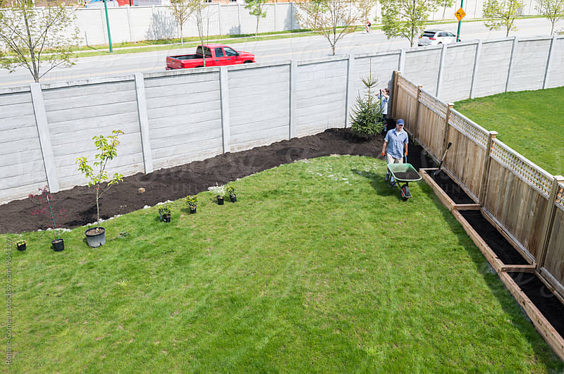 Family Creating A Backyard Garden by Ronnie Comeau for Stocksy United