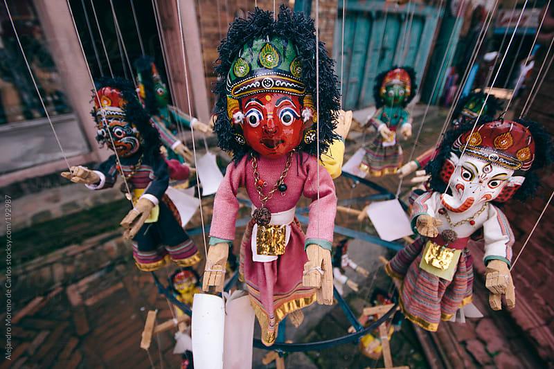 Asian handcraft puppets in Nepal market by Alejandro Moreno de Carlos for Stocksy United
