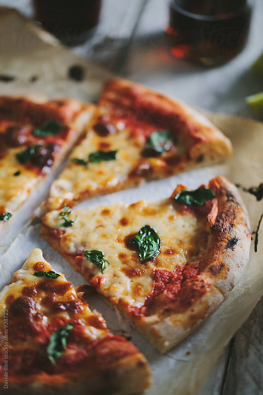 Italian pizza margherita by Davide Illini for Stocksy United