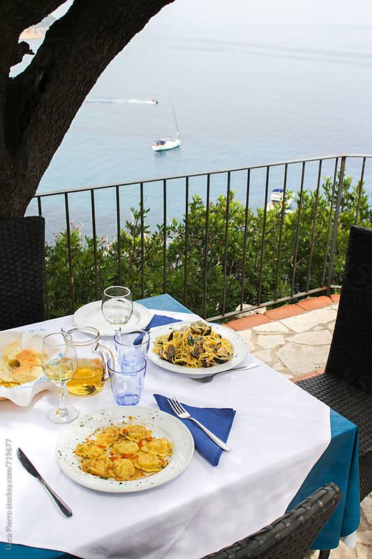 Typical Italian pasta served on a balcony in front of the sea by Luca Pierro for Stocksy United