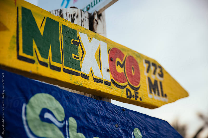 Mexico sign on a direction signpost by Alejandro Moreno de Carlos for Stocksy United