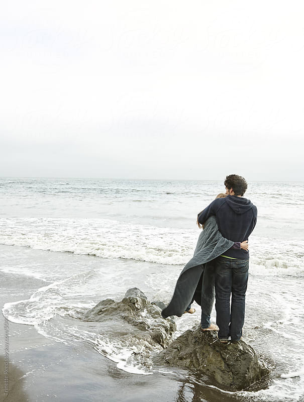 Young couple in love walking on the beach in California  by Trinette Reed for Stocksy United