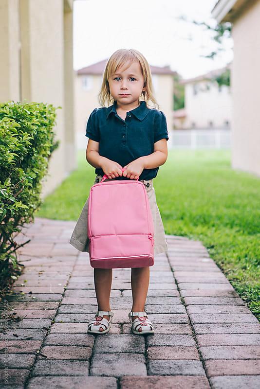 Little Girl Going to School by Stephen Morris for Stocksy United