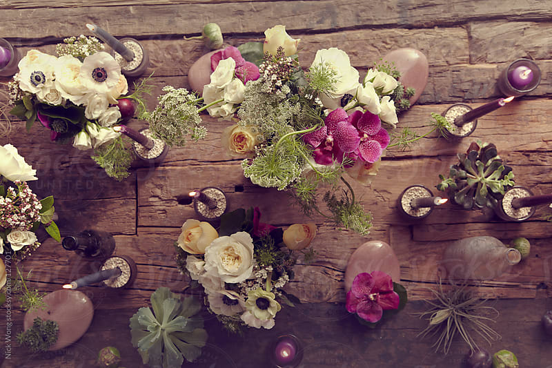 Floral Centrepiece on rustic wooden table by Nick Wong for Stocksy United