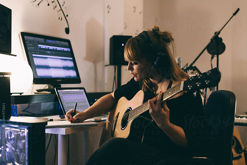Woman Recording Guitars in Her Home Sound Studio by VICTOR TORRES for Stocksy United