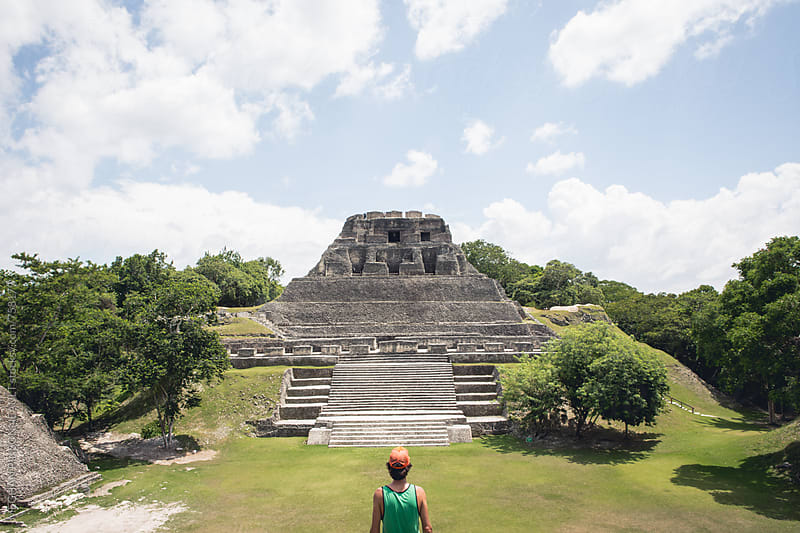 Man Admires Ancient Mayan Temple by MEGHAN PINSONNEAULT for Stocksy United
