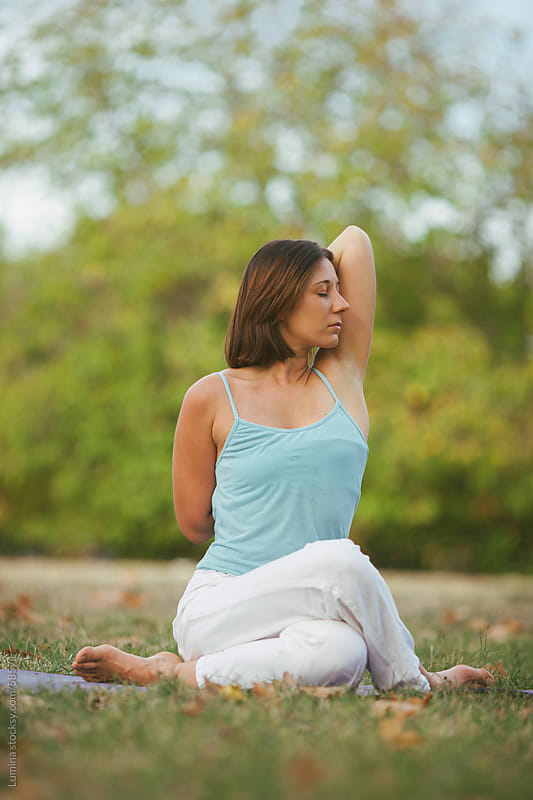 Caucasian Woman Meditating Outdoors by Lumina for Stocksy United