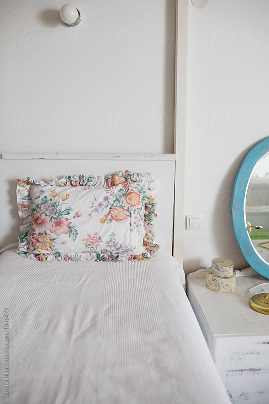 Bed and floral pillow by Jovana Rikalo for Stocksy United