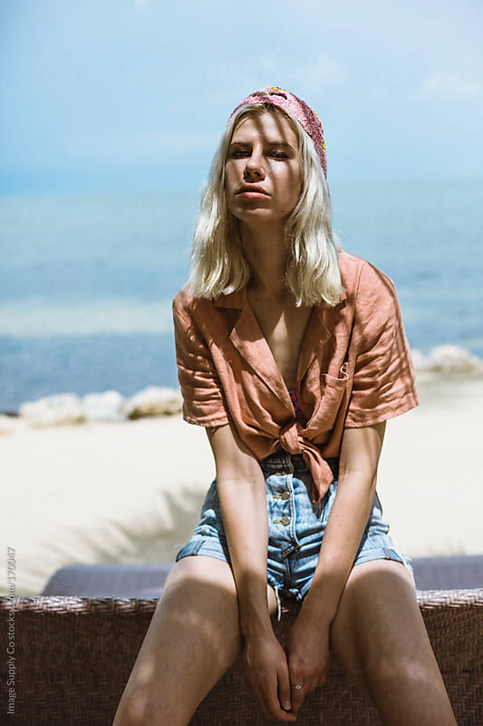 Blond girl relaxing beachside by Image Supply Co for Stocksy United