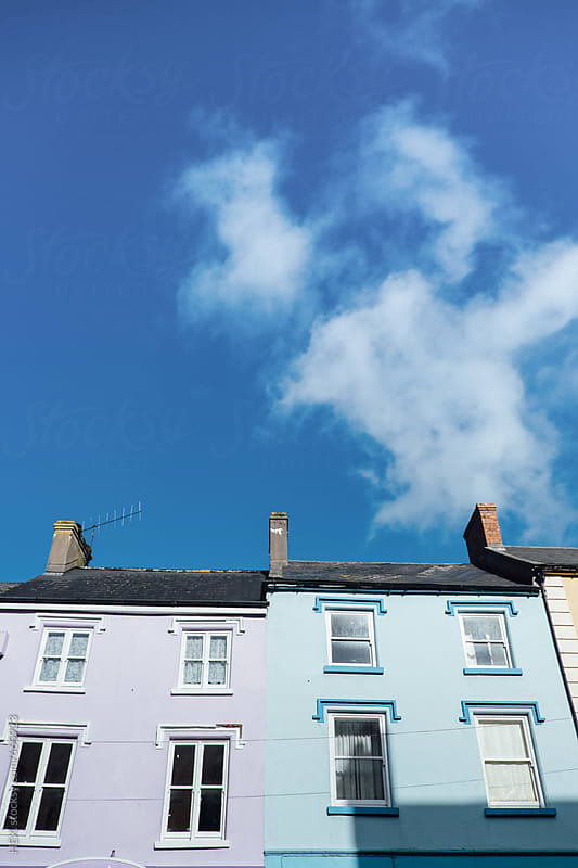 Houses Background under a Blue Sky by HEX. for Stocksy United