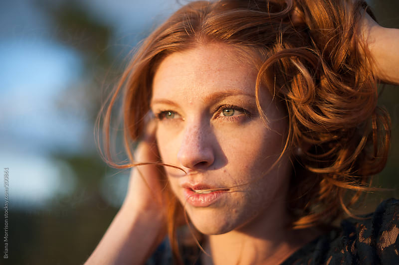 Redhead Woman at Sunset in Golden Light by Briana Morrison for Stocksy United