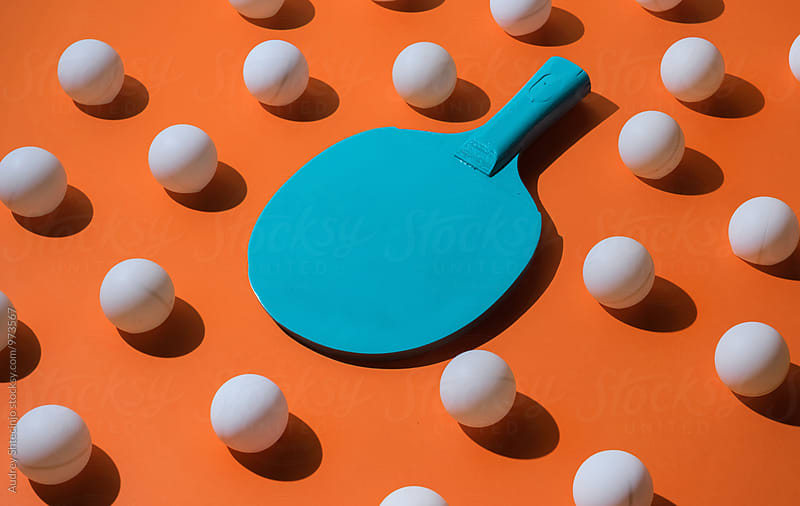 Blue ping pong racket with ball. by Marko Milanovic for Stocksy United