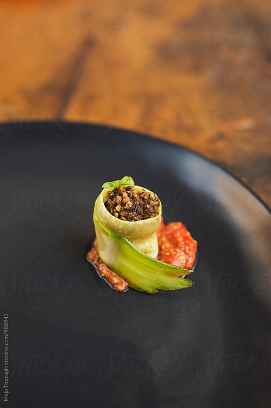 Raw food cabbage rolls by Maja Topcagic for Stocksy United