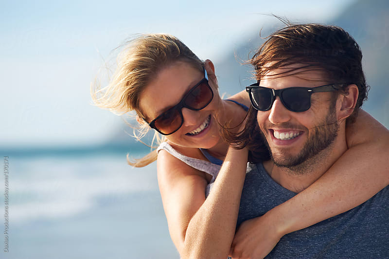 beach laughing couple by Daxiao Productions for Stocksy United