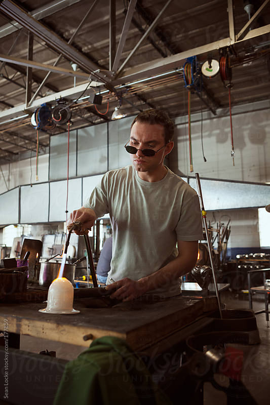 Glass: Man Uses Torch to Selectively Heat Glass Art by Sean Locke for Stocksy United