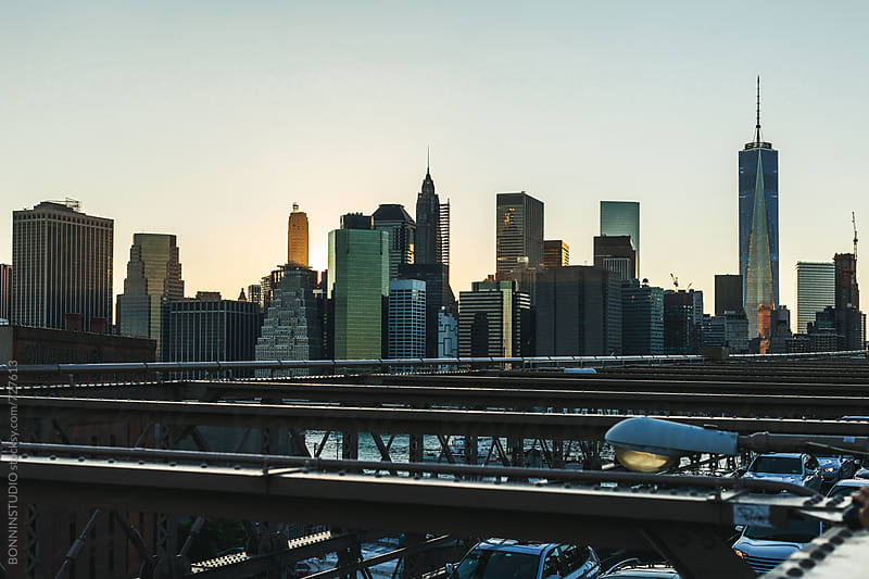 Manhattan financial district from Brooklyn bridge. by BONNINSTUDIO for Stocksy United