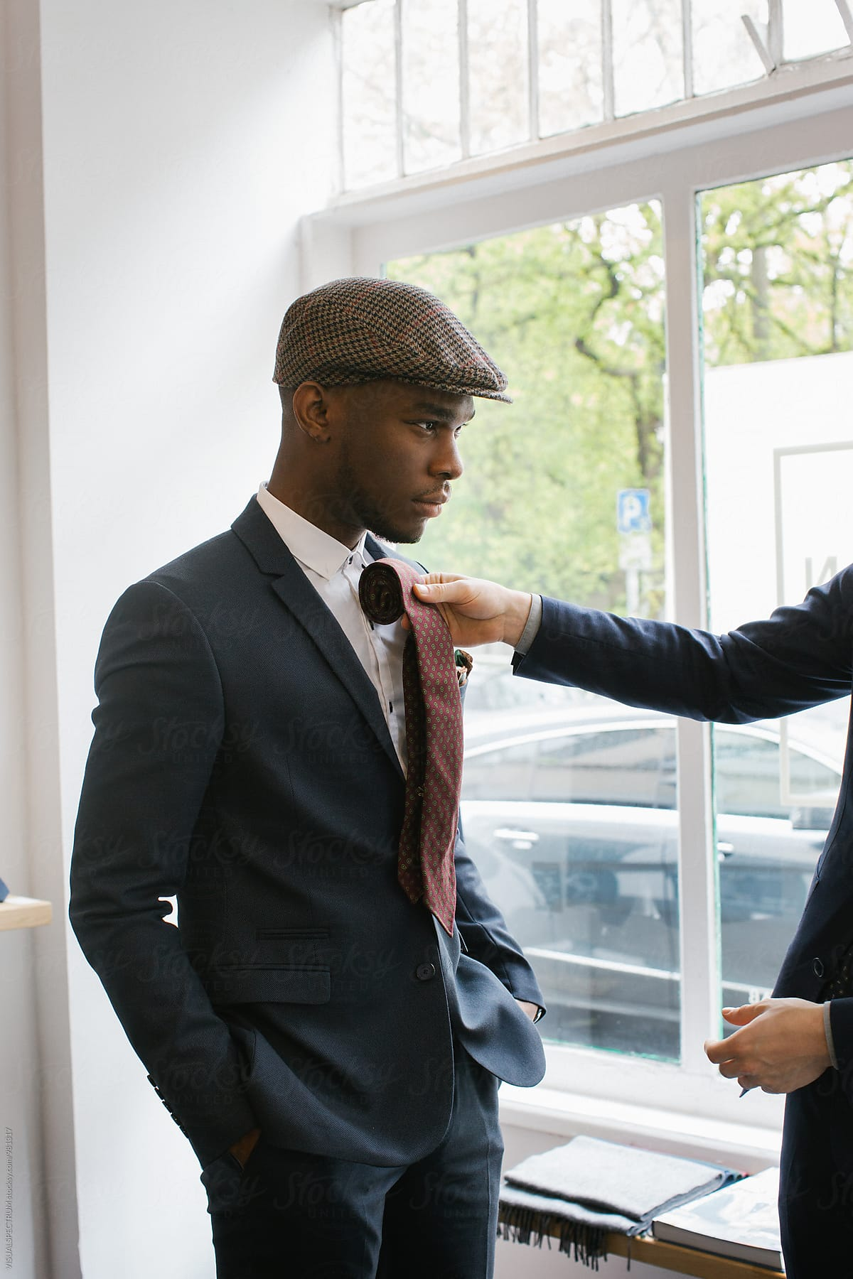 Men S Fashion Portrait Of Stylish Young Black Man Trying On Tie