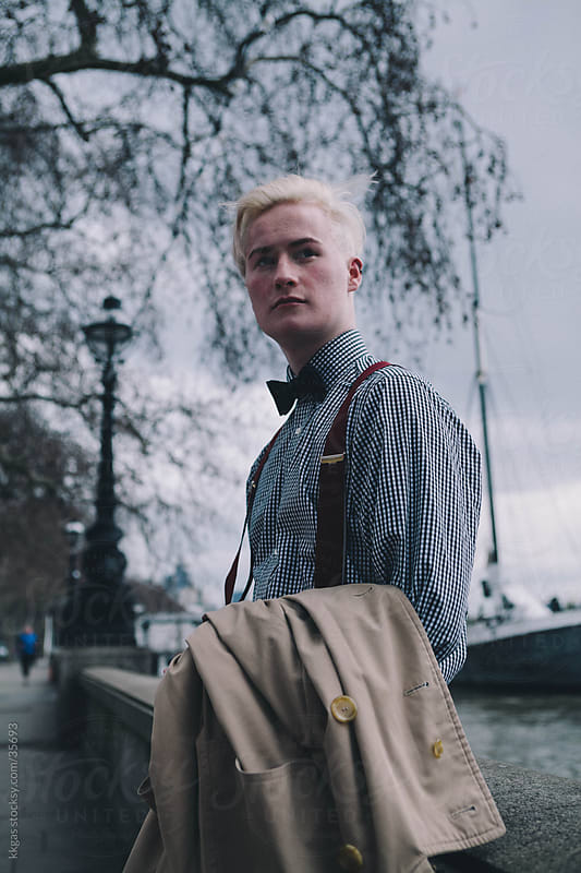 Fashionable young man next to the river Thames London. by kkgas for Stocksy United