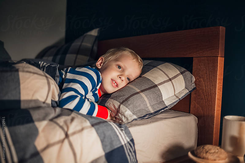 Blond Boy Lying in Bed by Lumina for Stocksy United