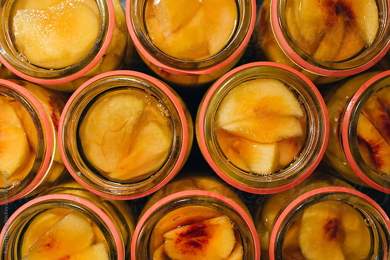Summer fruits, preserving fresh peaches by Robert Lang for Stocksy United