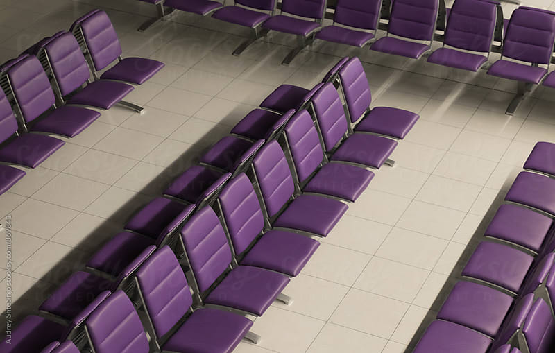 Line of purple chairs in row on waiting room on airport. by Audrey Shtecinjo for Stocksy United