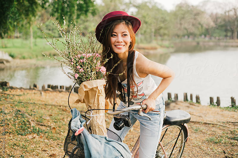 Beautiful Tourist on Bicycle by Marija Savic for Stocksy United