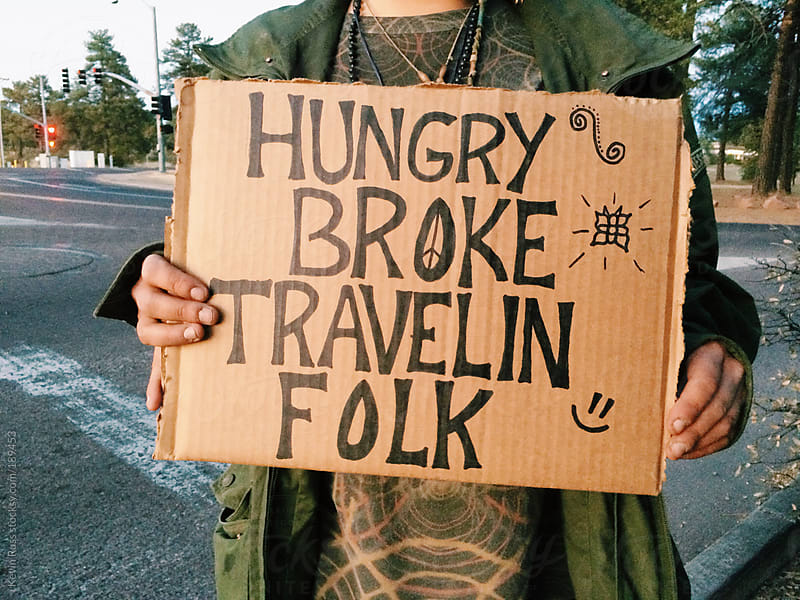 Woman Holding Sign For Money and Food by Kevin Russ for Stocksy United