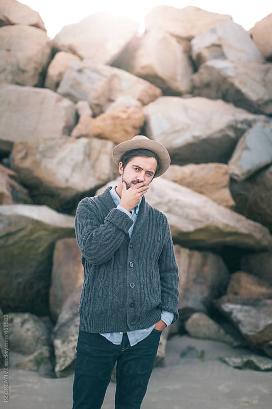 Portrait of stylish man wearing a hat at the beach by RZ CREATIVE for Stocksy United