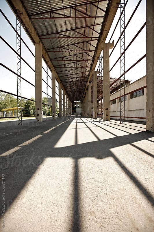 Metal construction of abandoned factory hangar by Bratislav Nadezdic for Stocksy United