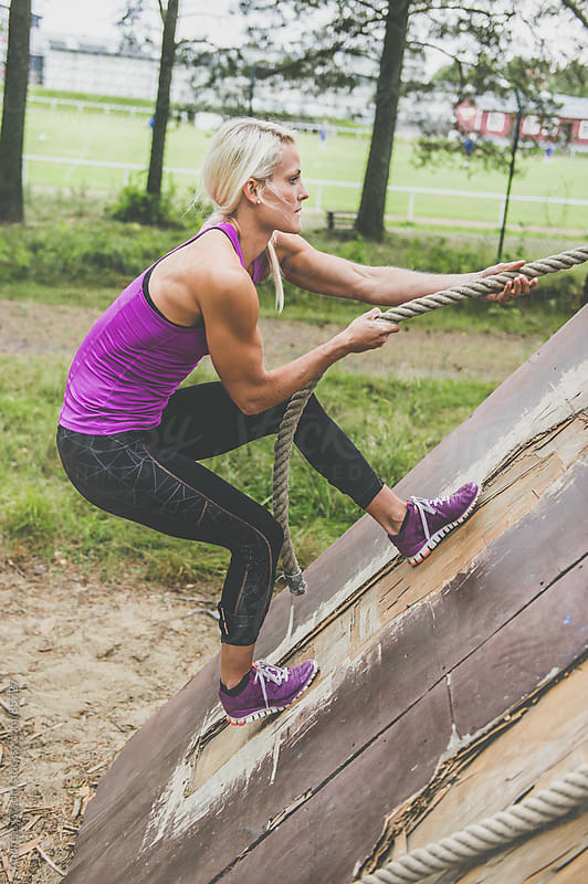 obstacle course workout by Andreas Gradin for Stocksy United