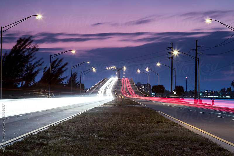 Blurred traffic lights at dusk by Adam Nixon for Stocksy United