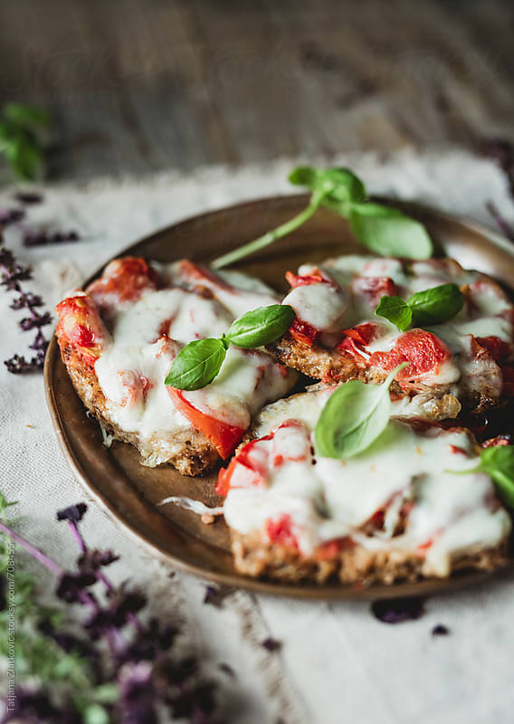 Sadnwiches with mozzarella and tomato by Tatjana Zlatkovic for Stocksy United