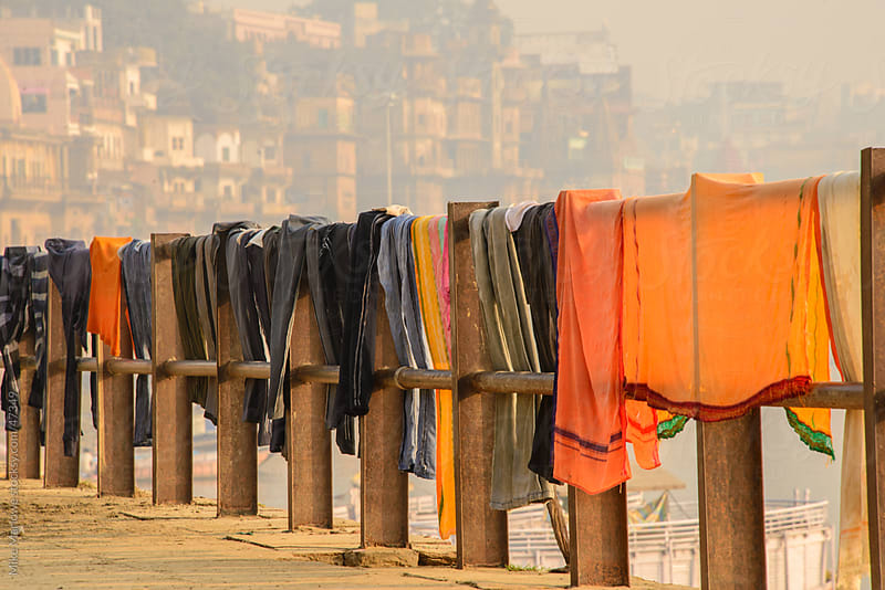 Clothes hanging over railings to dry in the sun. by Mike Marlowe for Stocksy United