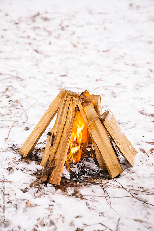 Photo of handmade fire in winter forest by Danil Nevsky for Stocksy United