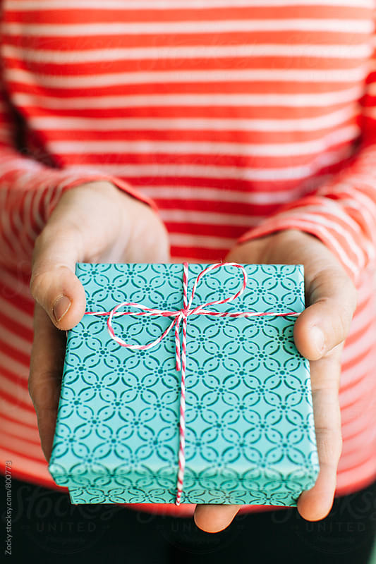 Young woman holding a christmas gift box by Zocky for Stocksy United