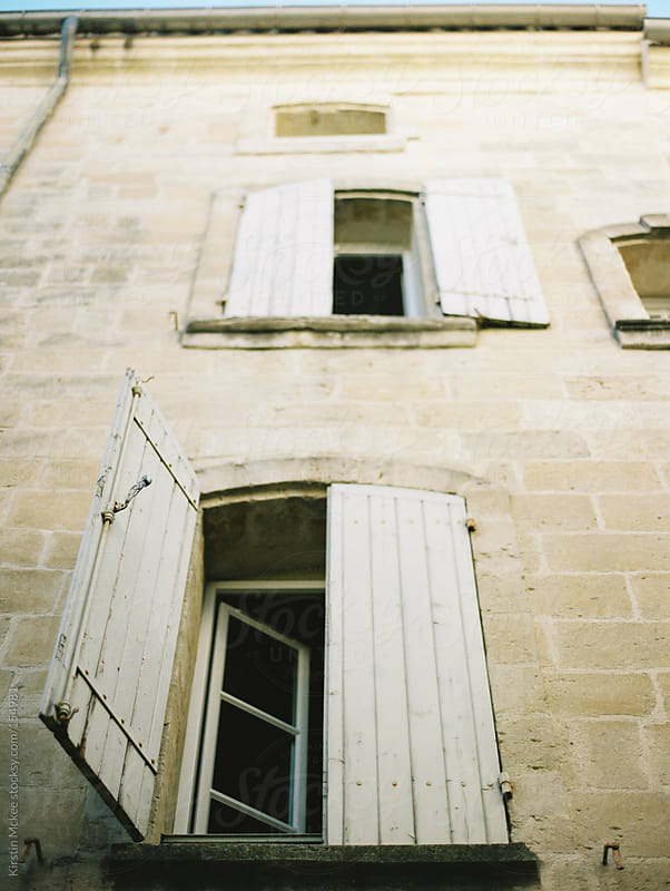 Exterior of a house, with shutters in France by Kirstin Mckee for Stocksy United