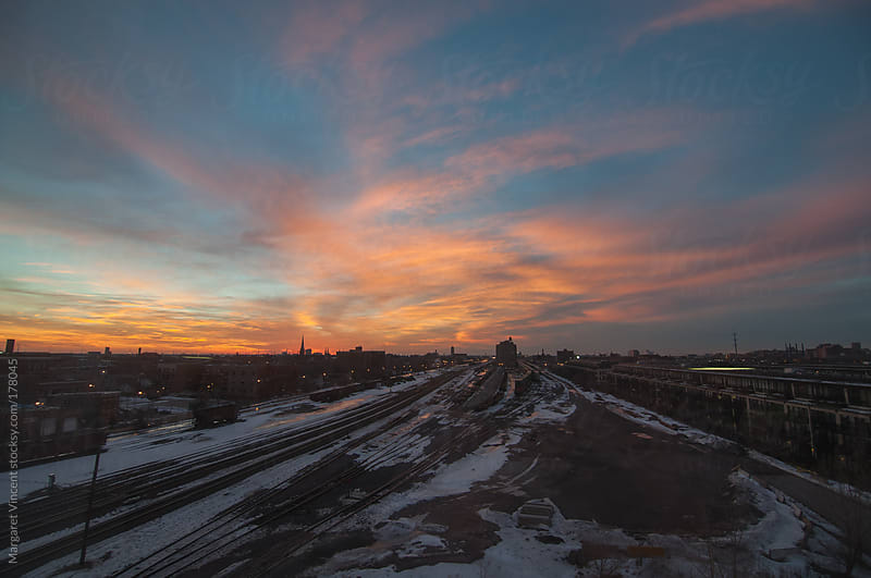sunset over train tracks by Margaret Vincent for Stocksy United