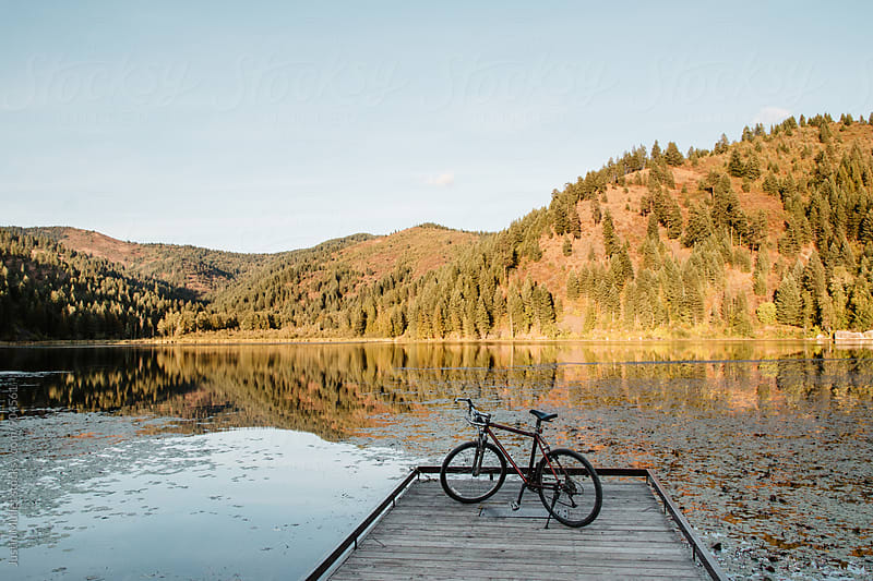 A mountain bike on the end of a wooden dock.  by Justin Mullet for Stocksy United